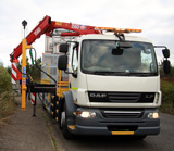 DAF 55/220 Chassis and Cab - Combined IPV and Barrier Rig, showing crane for lifting barrier sections, outrigger support and post driver
